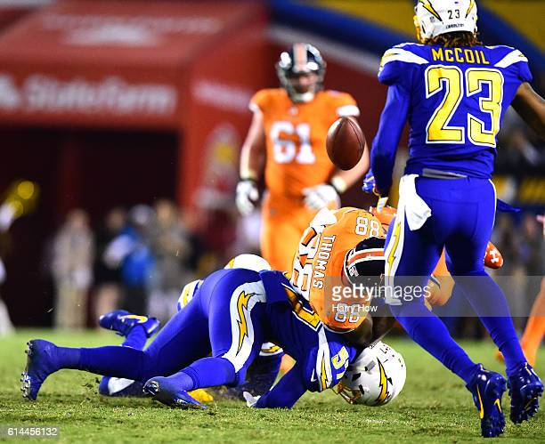Demaryius Thomas of the Denver Broncos fumbles on a hit from Jatavis Brown of the San Diego Chargers during the fourth quarter of a 2113 Chargers win...