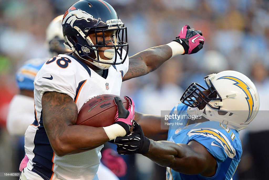 <a gi-track='captionPersonalityLinkClicked' href=/galleries/search?phrase=Demaryius+Thomas&family=editorial&specificpeople=4536795 ng-click='$event.stopPropagation()'>Demaryius Thomas</a> #88 of the Denver Broncos knocks <a gi-track='captionPersonalityLinkClicked' href=/galleries/search?phrase=Takeo+Spikes&family=editorial&specificpeople=209233 ng-click='$event.stopPropagation()'>Takeo Spikes</a> #51 of the San Diego Chargers away with a stiff arm at Qualcomm Stadium on October 15, 2012 in San Diego, California.