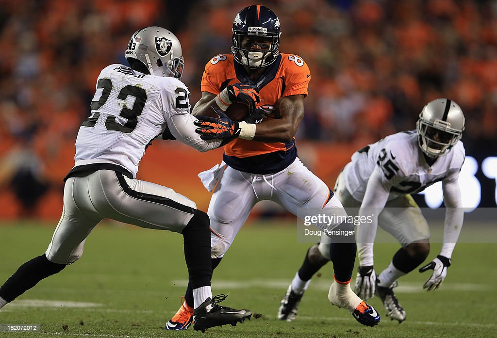 <a gi-track='captionPersonalityLinkClicked' href=/galleries/search?phrase=Demaryius+Thomas&family=editorial&specificpeople=4536795 ng-click='$event.stopPropagation()'>Demaryius Thomas</a> #88 of the Denver Broncos makes a reception against <a gi-track='captionPersonalityLinkClicked' href=/galleries/search?phrase=Tracy+Porter&family=editorial&specificpeople=2218516 ng-click='$event.stopPropagation()'>Tracy Porter</a> #23 of the Oakland Raiders and DJ Hayden #25 of the Oakland Raiders at Sports Authority Field at Mile High on September 23, 2013 in Denver, Colorado.