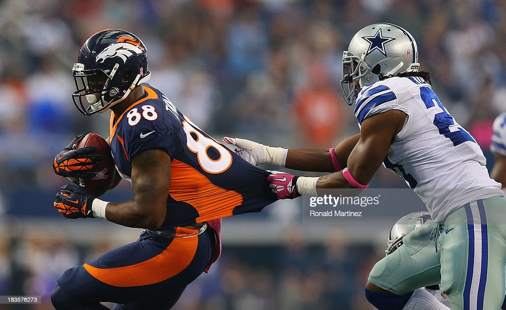 Demaryius Thomas of the Denver Broncos runs the ball against JJ Wilcox of the Dallas Cowboys at ATT Stadium on October 6 2013 in Arlington Texas