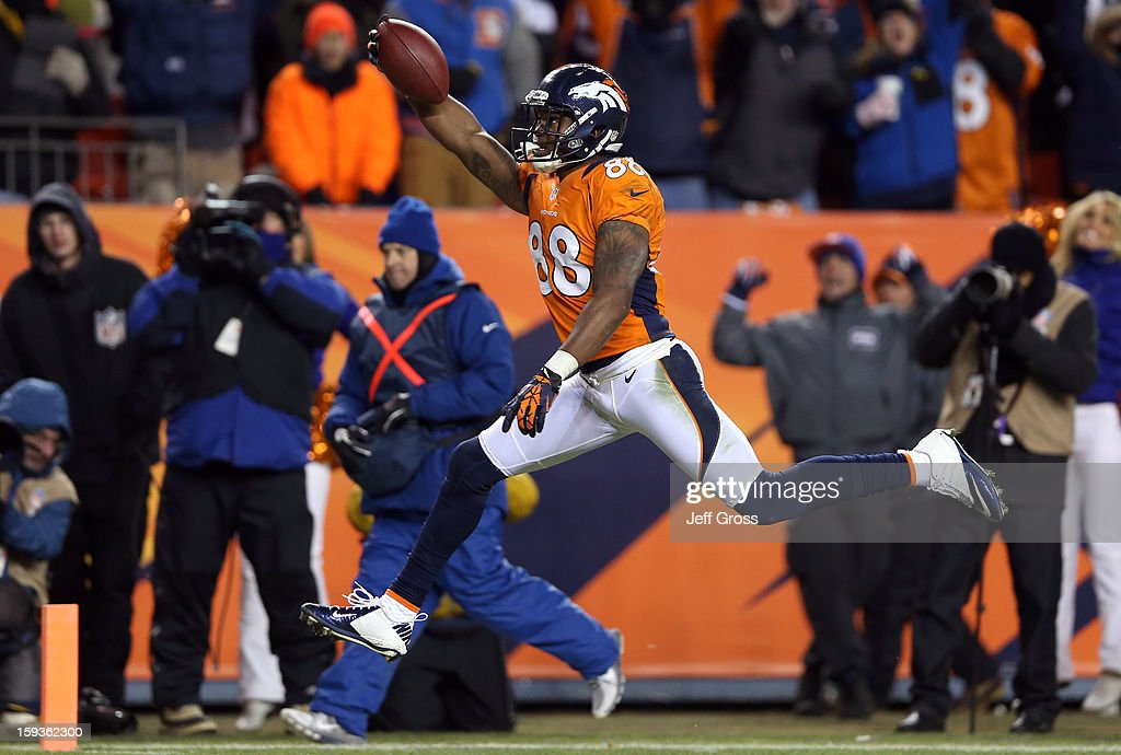 Demaryius Thomas #88 of the Denver Broncos scores a 17-yard touchdown reception in the fourth quarter against the Baltimore Ravens during the AFC Divisional Playoff Game at Sports Authority Field at Mile High on January 12, 2013 in Denver, Colorado.