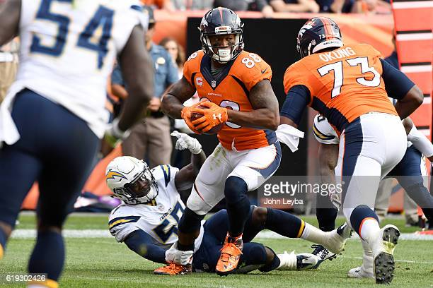 Demaryius Thomas of the Denver Broncos shakes a tackled attempt by Jatavis Brown of the San Diego Chargers during the first quarter on Sunday October...