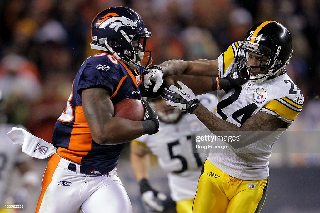 <a gi-track='captionPersonalityLinkClicked' href=/galleries/search?phrase=Demaryius+Thomas&family=editorial&specificpeople=4536795 ng-click='$event.stopPropagation()'>Demaryius Thomas</a> #88 of the Denver Broncos stiff arms <a gi-track='captionPersonalityLinkClicked' href=/galleries/search?phrase=Ike+Taylor&family=editorial&specificpeople=748703 ng-click='$event.stopPropagation()'>Ike Taylor</a> #24 of the Pittsburgh Steelers to score an 80 yard touchdown in overtime during the AFC Wild Card Playoff game at Sports Authority Field at Mile High on January 8, 2012 in Denver, Colorado. The Denver Broncos defeated the the Pittsburgh Steelers in overtime 23 - 29.