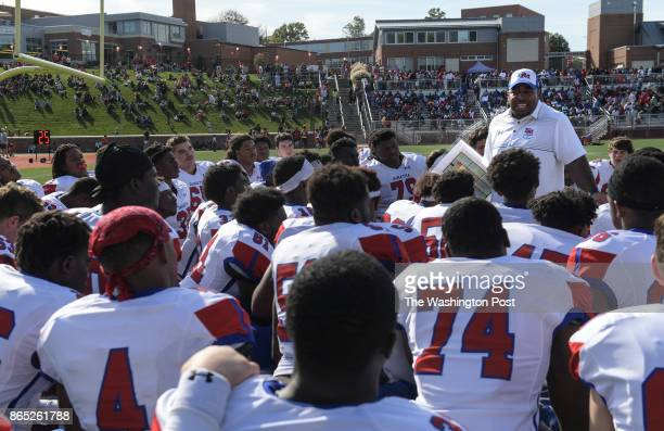 WASHINGTON DC OCTOBER DeMatha Stags head coach Elijah Brooks talks with his players on the field during halftime of the game between the St John's...