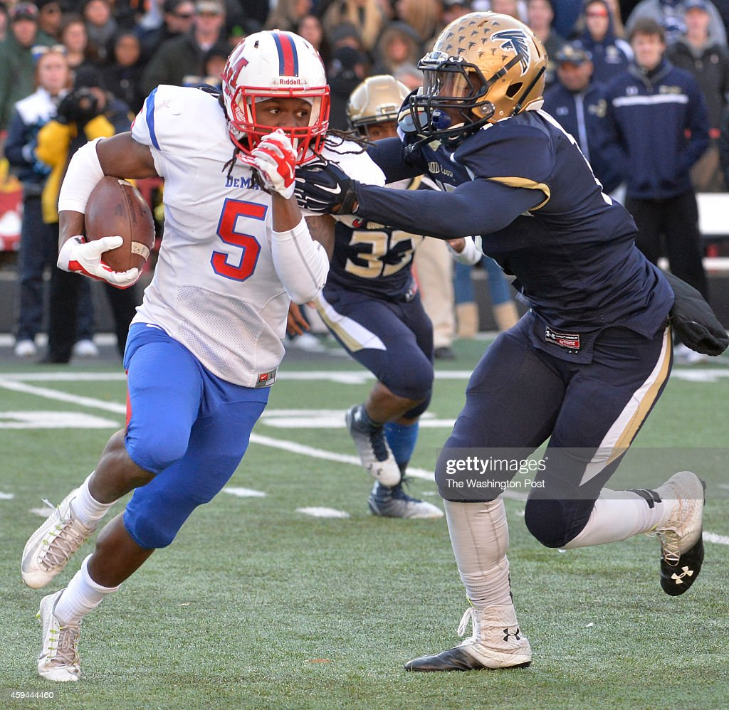 DeMathas Anthony McFarland looked to get away from Good Counsels Darius Fullwood in the second quarter in the Washington Catholic Athletic Conference...