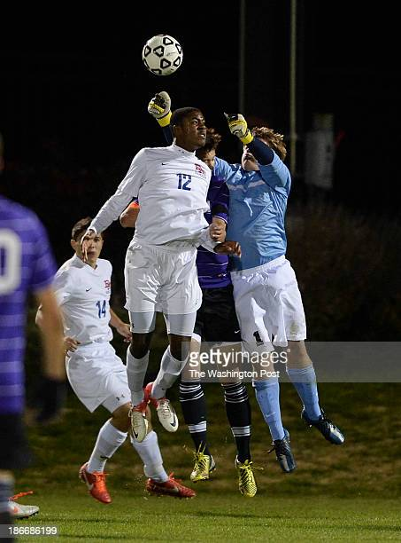 Dematha's Jordan Dove has a header taken away from Gonzaga goalie Tyler Olmstead on a corner kick during the WCAC Boys' Soccer Championship at the...