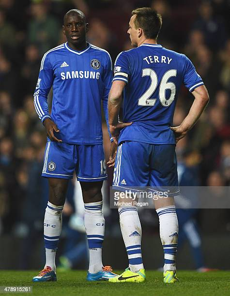 Demba Ba and John Terry of Chelsea look dejected in defeat after the Barclays Premier League match between Aston Villa and Chelsea at Villa Park on...