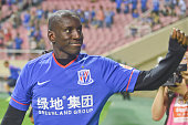 Demba Ba makes his debut prior to the CSL Chinese Football Association Super League match between Shanghai Shenhua and Guangzhou RF at Hongkou...