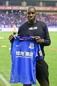Demba Ba makes his debut prior to the CSL Chinese Football Association Super League match between Shanghai Shenhua and Guangzhou RF at Hongkou...