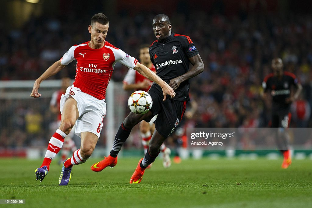 Demba Ba (R) of Besiktas and Arsenal's Laurent Koscielny (L) vie for the ball during the UEFA Champions League play-off second leg match between Arsenal and Besiktas at Emirates Stadium on August 27, 2014 in London, England.