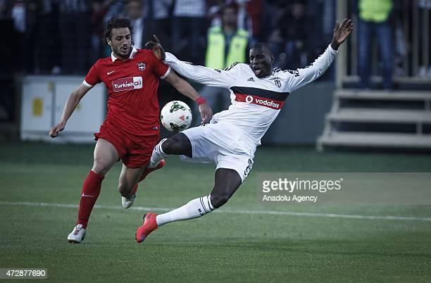 Demba Ba of Besiktas vies for the ball with Erdem Sen of Gaziantepspor during the Turkish Spor Toto Super League football match between Besiktas and...