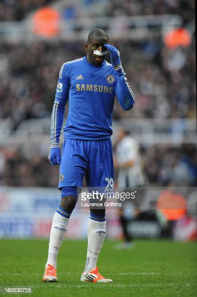 Demba Ba of Chelsea after being kicked in the face by Fabricio Coloccini of Newcastle United during the Barclays Premier League match between...