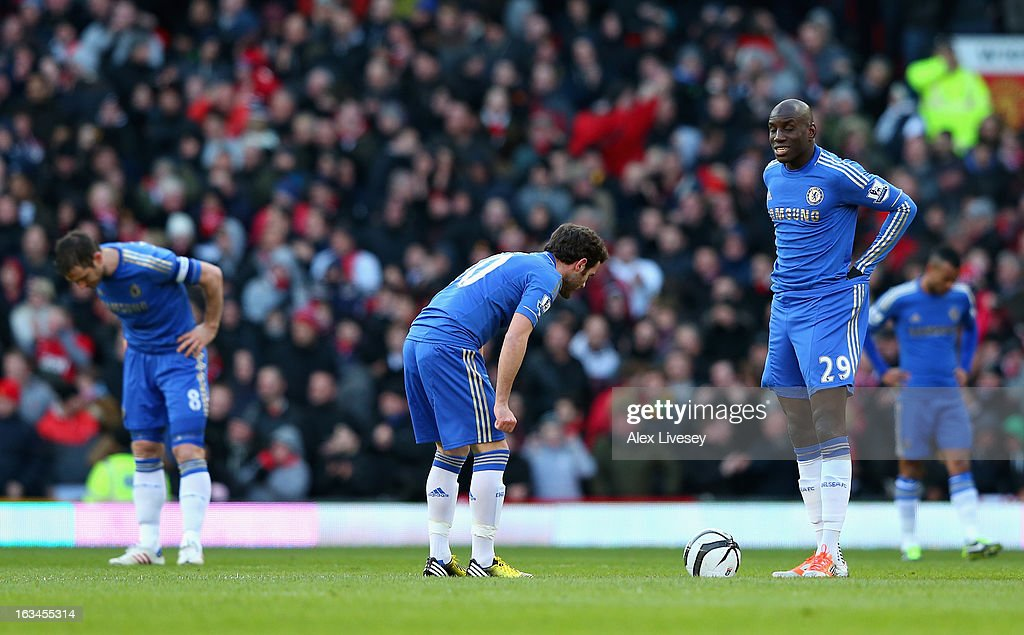 Demba Ba (r) of Chelsea and his team-mates look dejected after conceding during the FA Cup sponsored by Budweiser Sixth Round match between Manchester United and Chelsea at Old Trafford on March 10, 2013 in Manchester, England.