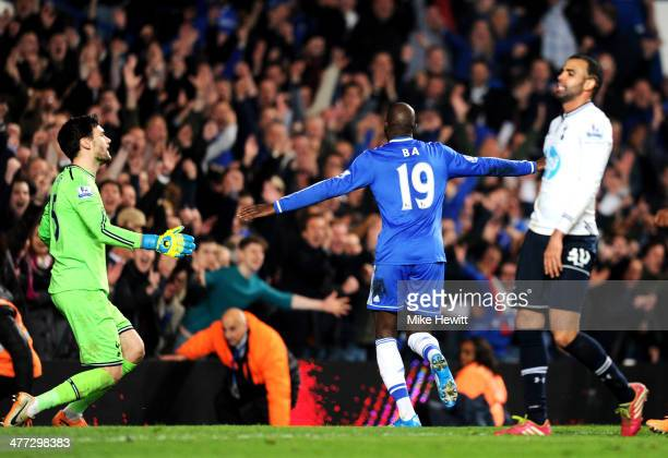 Demba Ba of Chelsea celebrates after scoring his team's third goal during the Barclays Premier League match between Chelsea and Tottenham Hotspur at...