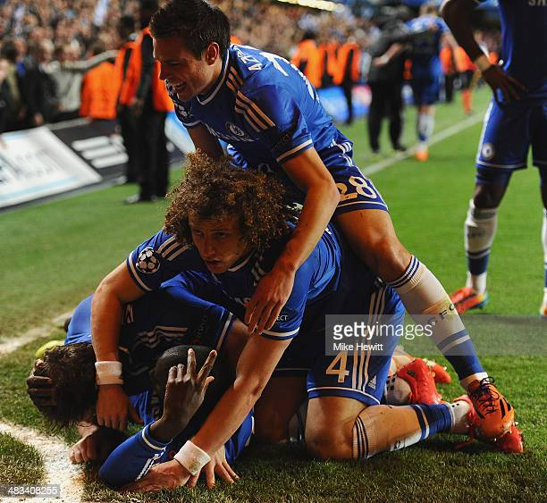 Demba Ba of Chelsea celebrates scoring their second goal with team mates during the UEFA Champions League Quarter Final second leg match between...