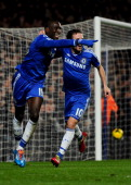 Demba Ba of Chelsea celebrates with Juan Mata as he scores their third goal during the Barclays Premier League match between Chelsea and Southampton...