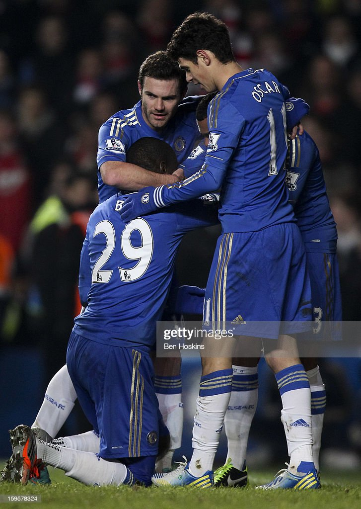 <a gi-track='captionPersonalityLinkClicked' href=/galleries/search?phrase=Demba+Ba&family=editorial&specificpeople=4510297 ng-click='$event.stopPropagation()'>Demba Ba</a> of Chelsea celebrates with team mates after scoring the opening goal of the game during the Barclays Premier League match between Chelsea and Southampton at Stamford Bridge on January 16, 2013 in London, England.