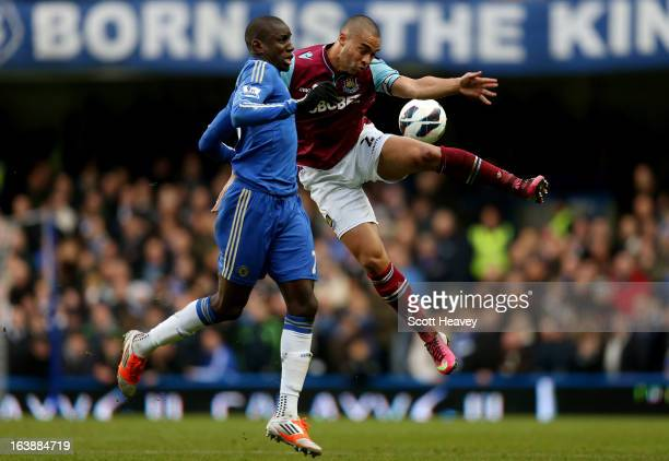 Demba Ba of Chelsea challenges Winston Reid of West Ham during the Barclays Premier League match between Chelsea and West Ham United at Stamford...