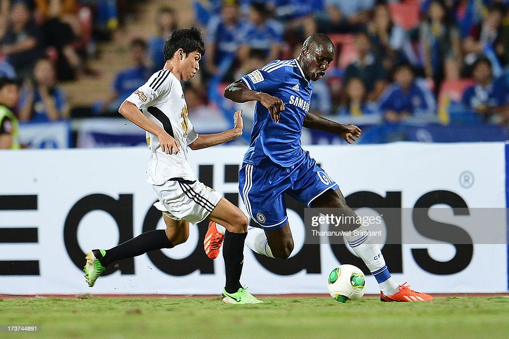Demba Ba of Chelsea FC with Apipoo Suntornpanavej of Singha All-star during the international friendly match between Chelsea FC and the Singha Thailand All-Star XI on July 17, 2013 in Bangkok, Thailand.