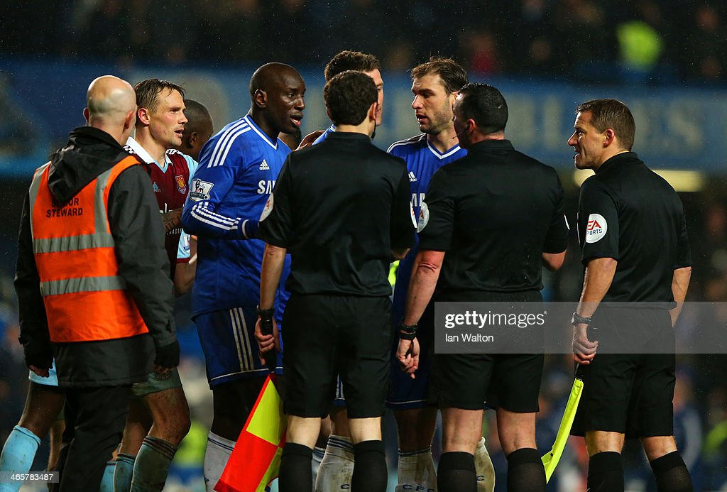 <a gi-track='captionPersonalityLinkClicked' href=/galleries/search?phrase=Demba+Ba&family=editorial&specificpeople=4510297 ng-click='$event.stopPropagation()'>Demba Ba</a> of Chelsea has words with Referee Neil Swarbrick during the Barclays Premier League match between Chelsea and West Ham United at Stamford Bridge on January 29, 2014 in London, England.