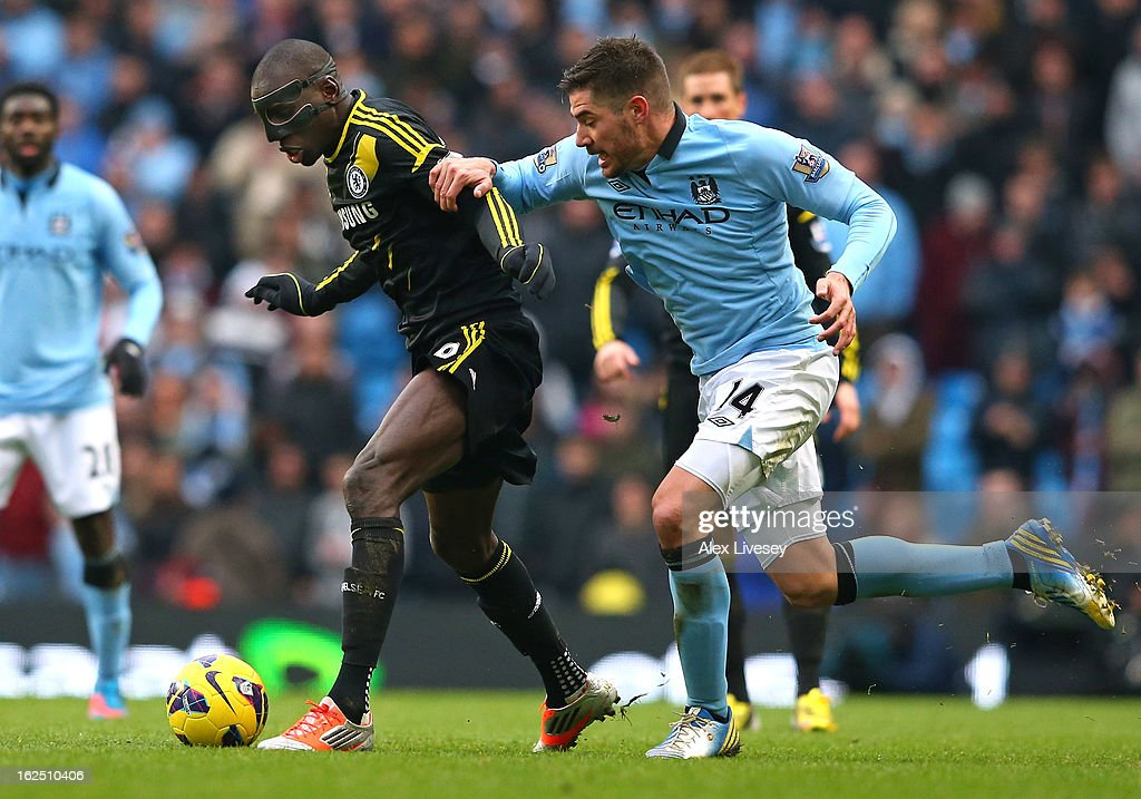 Demba Ba of Chelsea holds off a challenge from Javi Garcia during the Barclays Premier League match between Manchester City and Chelsea at Etihad Stadium on February 24, 2013 in Manchester, England.