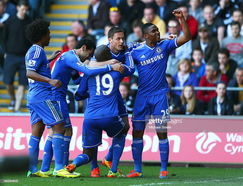 <a gi-track='captionPersonalityLinkClicked' href=/galleries/search?phrase=Demba+Ba&family=editorial&specificpeople=4510297 ng-click='$event.stopPropagation()'>Demba Ba</a> #19 of Chelsea is congratulated by teammates after scoring the opening goal during the Barclays Premier League match between Swansea City and Chelsea at Liberty Stadium on April 13, 2014 in Swansea, Wales.