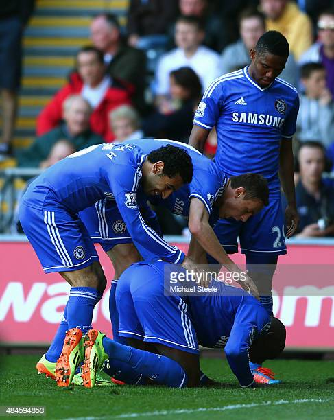 Demba Ba of Chelsea is congratulated by teammates after scoring the opening goal during the Barclays Premier League match between Swansea City and...