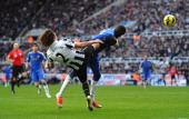 Demba Ba of Chelsea is kicked in the face by Fabricio Coloccini of Newcastle United during the Barclays Premier League match between Newcastle United...