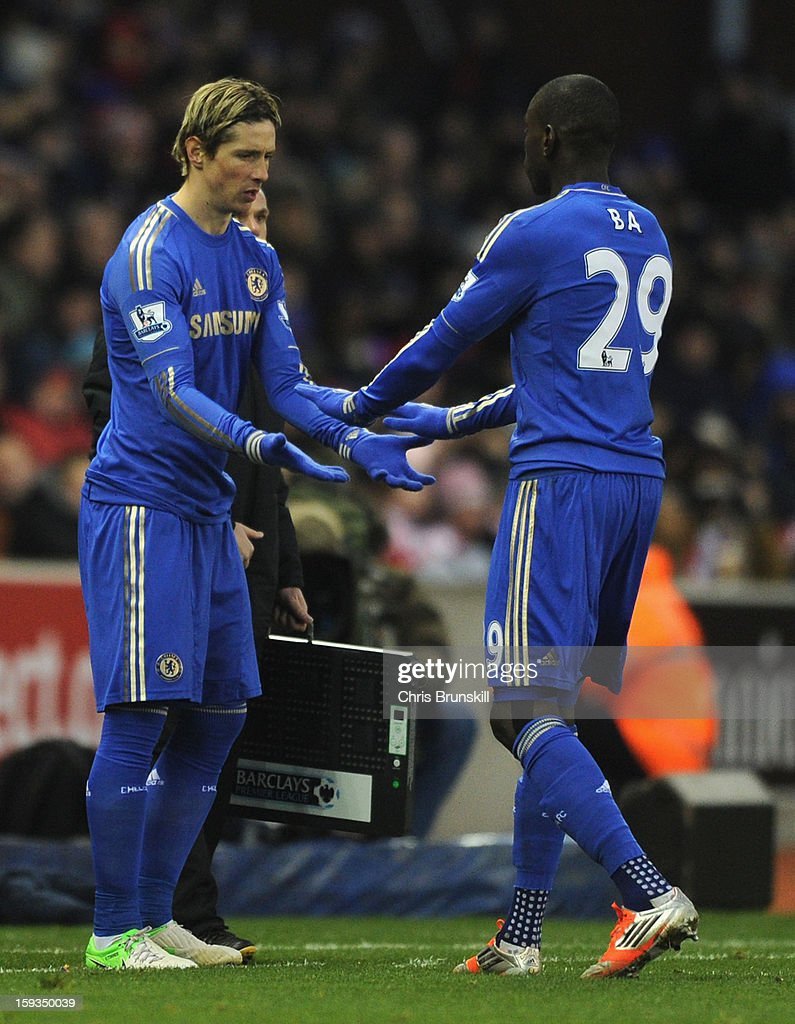 <a gi-track='captionPersonalityLinkClicked' href=/galleries/search?phrase=Demba+Ba&family=editorial&specificpeople=4510297 ng-click='$event.stopPropagation()'>Demba Ba</a> of Chelsea is replaced by team-mate <a gi-track='captionPersonalityLinkClicked' href=/galleries/search?phrase=Fernando+Torres&family=editorial&specificpeople=194755 ng-click='$event.stopPropagation()'>Fernando Torres</a> during the Barclays Premier League match between Stoke City and Chelsea at the Britannia Stadium on January 12, 2013, in Stoke-on-Trent, England.