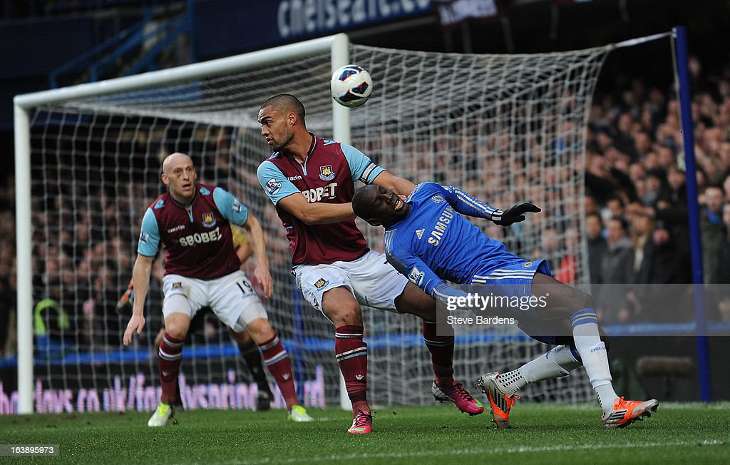 Demba Ba of Chelsea is tackled by Winston Reid of West Ham United during the Barclays Premier League match between Chelsea and West Ham United at Stamford Bridge on March 17, 2013 in London, England.