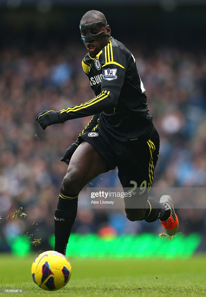 Demba Ba of Chelsea runs with the ball during the Barclays Premier League match between Manchester City and Chelsea at Etihad Stadium on February 24, 2013 in Manchester, England.