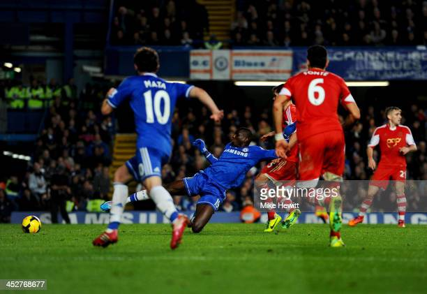 Demba Ba of Chelsea scores their third goal during the Barclays Premier League match between Chelsea and Southampton at Stamford Bridge on December 1...