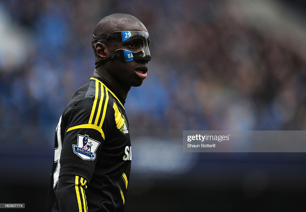 Demba Ba of Chelsea wears a protective mask during the Barclays Premier League match between Manchester City and Chelsea at Etihad Stadium on February 24, 2013 in Manchester, England.