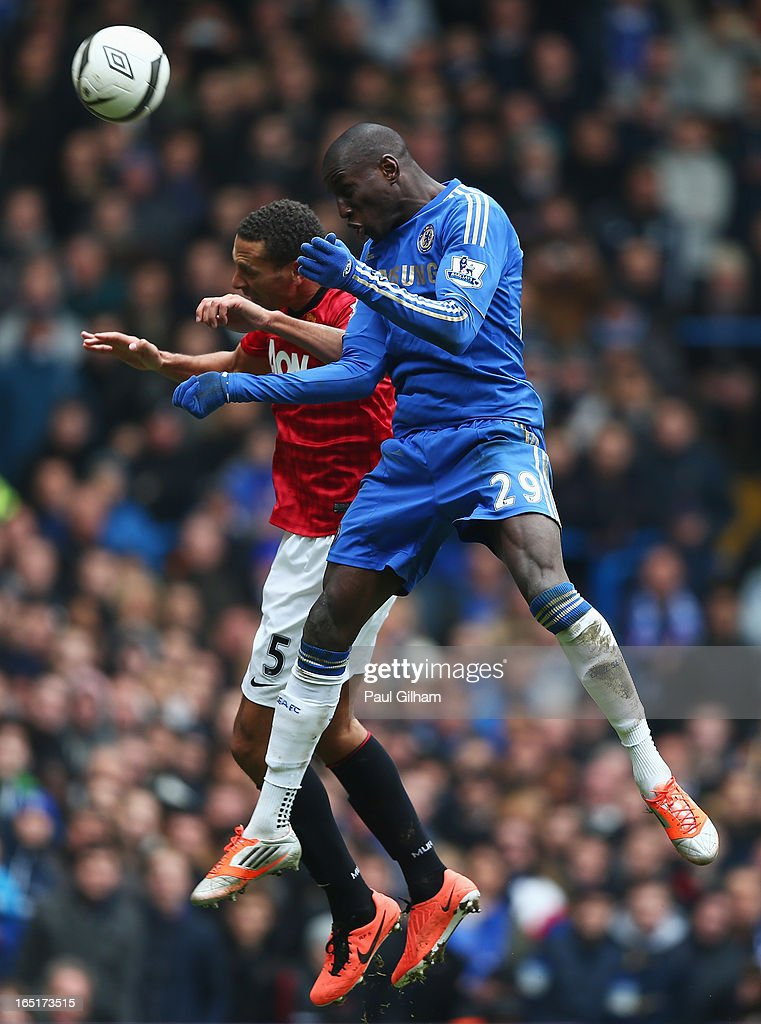 <a gi-track='captionPersonalityLinkClicked' href=/galleries/search?phrase=Demba+Ba&family=editorial&specificpeople=4510297 ng-click='$event.stopPropagation()'>Demba Ba</a> of Chelsea wins a header against <a gi-track='captionPersonalityLinkClicked' href=/galleries/search?phrase=Rio+Ferdinand&family=editorial&specificpeople=157538 ng-click='$event.stopPropagation()'>Rio Ferdinand</a> of Manchester United during the FA Cup with Budweiser Sixth Round Replay match between Chelsea and Manchester United at Stamford Bridge on April 1, 2013 in London, England.