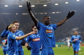 Demba Ba of Hoffenheim celebrates his team's second goal with team mates during the DFB Cup round of sixteen match between 1899 Hoffenheim and...
