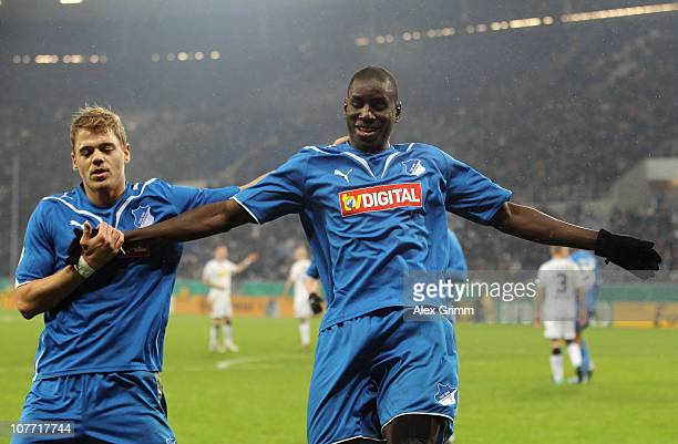 Demba Ba of Hoffenheim celebrates his team's second goal with team mate Boris Vukcevic during the DFB Cup round of sixteen match between 1899...