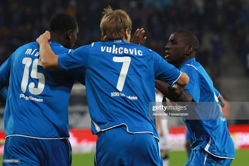 Demba Ba (R) of Hoffenheim celebrates scoring his second team goal with his team mates Boris Vukcevic (C) and Peniel Mlapa (L) during the Bundesliga match between 1899 Hoffenheim and Borussia Moenchengladbach at Rhein-Neckar Arena on October 17, 2010 in Sinsheim, Germany.