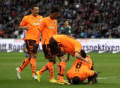 Demba Ba of Hoffenheim celebrates with his team mates after scoring his team's first goal during the Bundesliga match between Hertha BSC Berlin v...