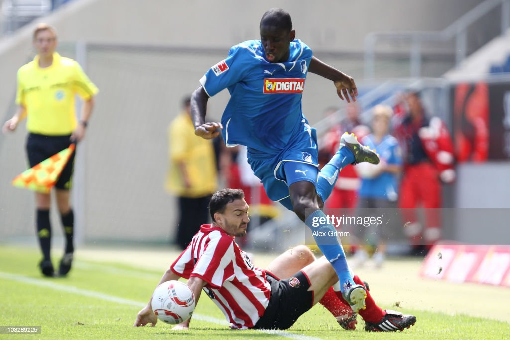 <a gi-track='captionPersonalityLinkClicked' href=/galleries/search?phrase=Demba+Ba&family=editorial&specificpeople=4510297 ng-click='$event.stopPropagation()'>Demba Ba</a> (top) of Hoffenheim is challenged by <a gi-track='captionPersonalityLinkClicked' href=/galleries/search?phrase=Steed+Malbranque&family=editorial&specificpeople=206647 ng-click='$event.stopPropagation()'>Steed Malbranque</a> of Sunderland during the pre-season friendly match between 1899 Hoffenheim and Sunderland AFC at the Rhein-Neckar Arena on August 8, 2010 in Sinsheim, Germany.