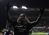 Demba Ba of Newcastle United celebrates scoring his third goal during the Barclays Premier League match between Stoke City and Newcastle United at...
