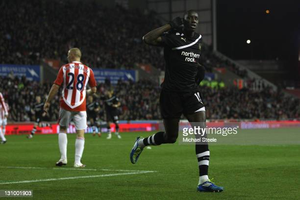 Demba Ba of Newcastle United celebrates scoring the opening goal during the Barclays Premier League match between Stoke City and Newcastle United at...