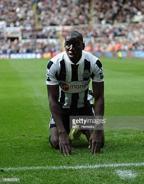 Demba Ba of Newcastle United celebrates scoring the opening goal during the Barclays Premier League match between Newcastle United and Norwich City...