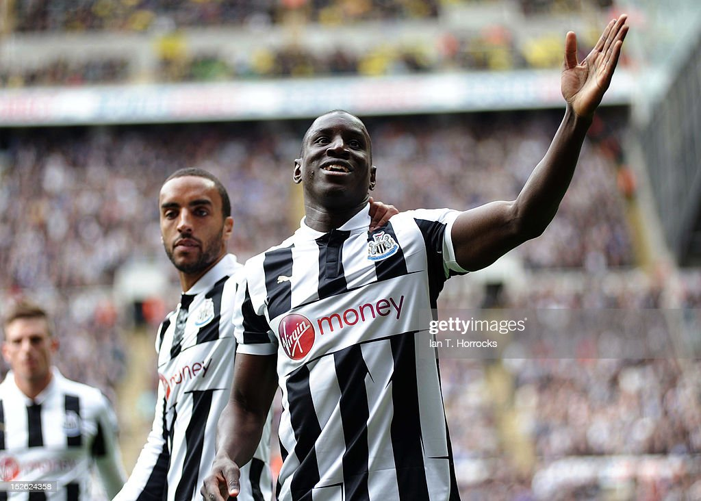 <a gi-track='captionPersonalityLinkClicked' href=/galleries/search?phrase=Demba+Ba&family=editorial&specificpeople=4510297 ng-click='$event.stopPropagation()'>Demba Ba</a> of Newcastle United celebrates scoring the opening goal during the Barclays Premier League match between Newcastle United and Norwich City at Sports Direct Arena on September 23, 2012, in Newcastle upon Tyne, England.