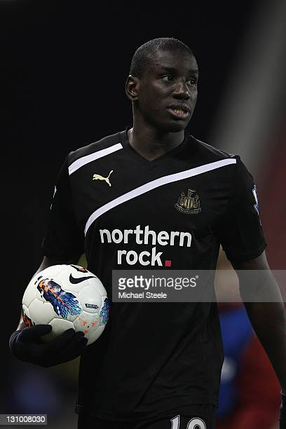 Demba Ba of Newcastle United claims the match ball after his hat trick of goals in his sides 31 victory during the Barclays Premier League match...