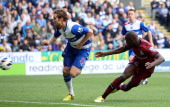 Demba Ba of Newcastle United scores his second equalizing goal during the Barclays Premier League match between Newcastle United and Reading at The...