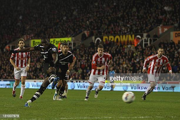 Demba Ba of Newcastle United scores his third goal during the Barclays Premier League match between Stoke City and Newcastle United at the Britannia...