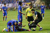 Demba Ba of Shanghai Shenhua lies on ground after breaking his left leg during the 17th round match of the Chinese Super League between Shanghai...