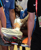 Demba Ba of Shanghai Shenhua lies on the stretcher after breaking his left leg during the 17th round match of the Chinese Super League between...