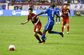 Demba Ba of Shanghai Shenhua vies with Sun Xiang of Shanghai SIPG during the 17th round match of the Chinese Super League between Shanghai Greenland...