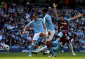 Demba Ba of West Ham United scores his team's first goal during the Barclays Premier League match between Manchester City and West Ham United at the...